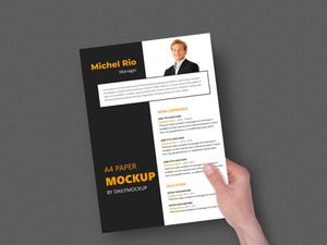 Hand Holding A4 Mockup Paper